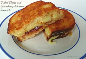 grilled cheese with strawberry-jalapeno jam cut