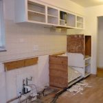 Demo the old, less functional kitchen