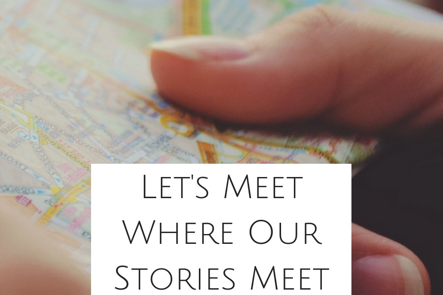 Button Photo of Hand Holding Map Let's Meet Where Our stories Meet